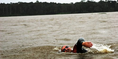 Martin Strel, the world long distance swimming record holder, is swimming in the Amazon river during the rainy forest storm.
