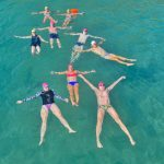 Swimming-Group-Relaxing-in-the-Turquoise-Sea